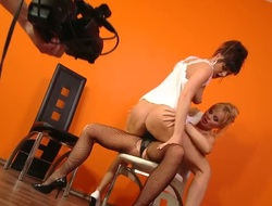 Sandra Sanchez bonks Silvia Saint with an attached strap-on during the time that the crew is filming it all and getting boners from the sight of these two lesbians.