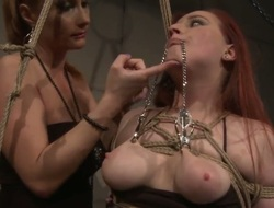 Attractive lengthy haired bitch Katy Parker with hot ponytail and darksome heavy make up tortures tied up redhead Kyra with natural marangos and large booty in memorable thraldom fantasy.