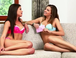 Gorgeous cuties are sitting on one sofa in their sexual expensive lingerie discussing different sometimes so private themes. They are in anticipation of having lesbian sex.